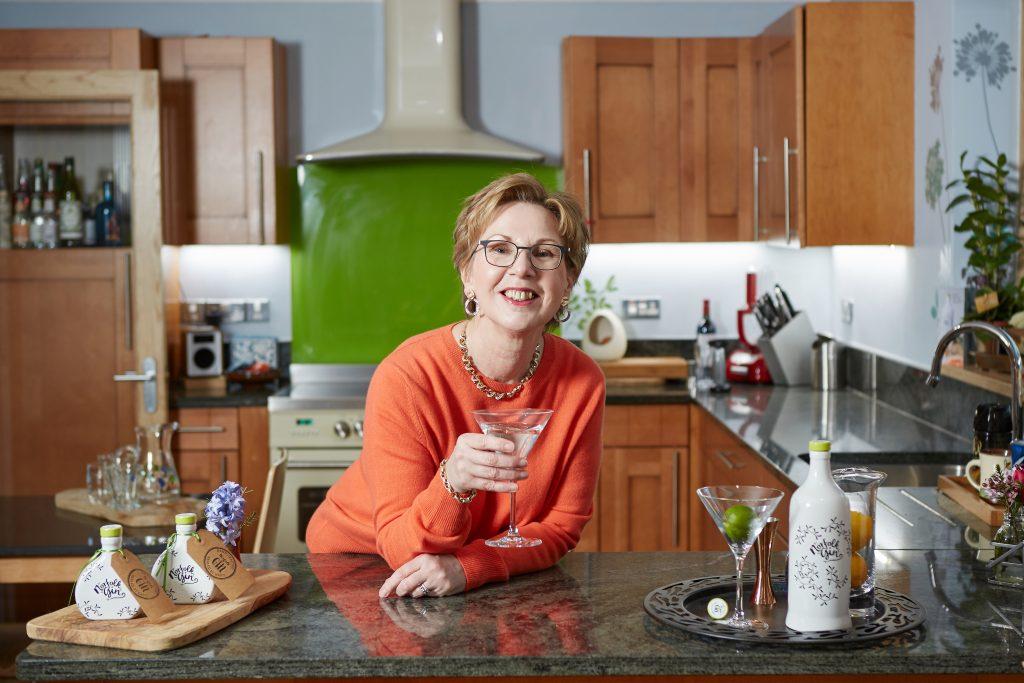 Alison enjoying a Norfolk Gin at home.