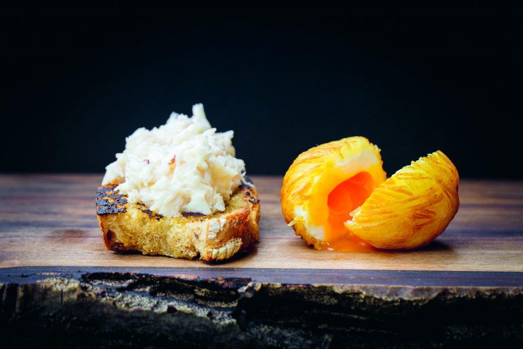 Crab toasties and potato-wrapped quail egg, prepared by Galton Blackiston