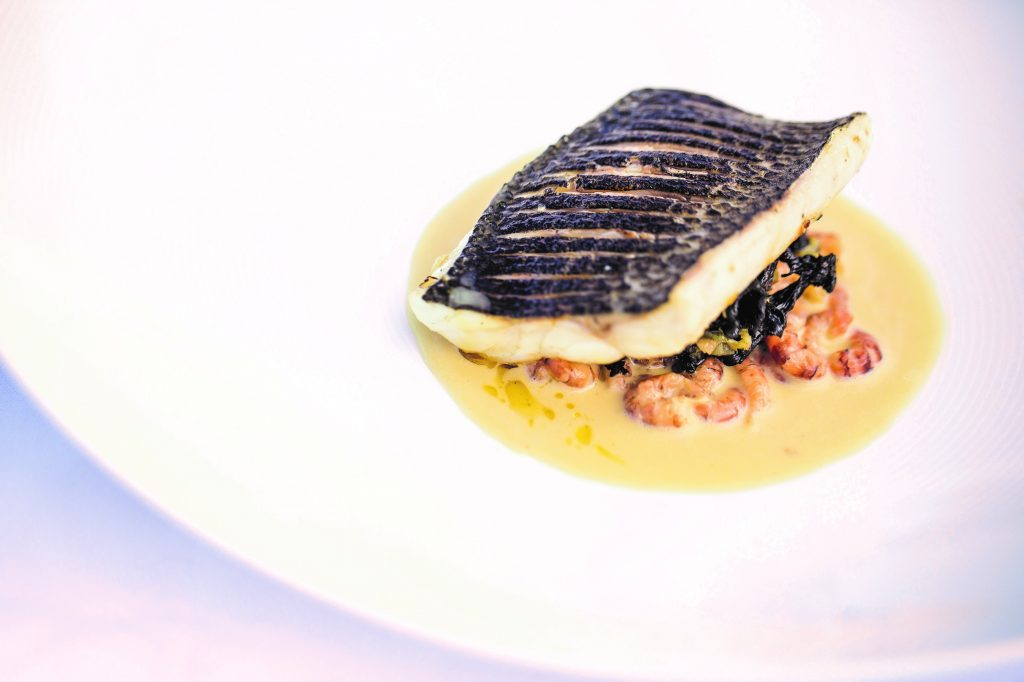 Sea bass, champagne and shrimp sauce, made by Galton Blackiston